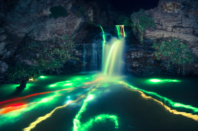 laughingsquid:  Long Exposure Photos of Glowsticks in Waterfalls