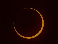 "spacettf:   Cape York Annular Eclipse  Image Credit & Copyright: Courtesy Cameron McCarty - MWV Observatory, Coca-Cola Space Science Center, Columbus State Univ. Eclipse Team  Explanation:  This week the shadow of the New Moon fell on planet Earth, crossing Queensland's Cape York in northern Australia … for the second time in six months. On the morning of May 10, the Moon's apparent size was too small to completely cover the Sun though, revealing a ""ring of fire"" along the central path of the annular solar eclipse. Near mid-eclipse from Coen, Australia, a webcast team captured this telescopic snapshot of the annular phase. Taken with a hydrogen-alpha filter, the dramatic image finds the Moon's silhouette just within the solar disk, and the limb of the active Sun spiked with solar prominences. Still, after hosting back-to-back solar eclipses, northern Australia will miss the next and final solar eclipse of 2013. This November, a rare hybrid eclipse will track across the North Atlantic and equatorial Africa."