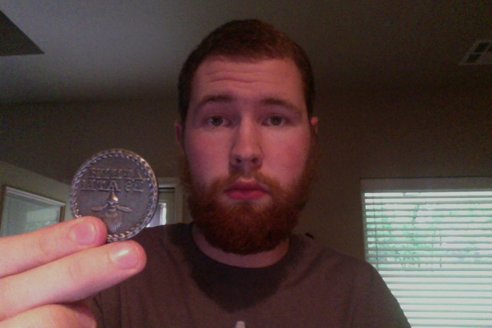 "Here is Keegan Meenagh with his Beard Token. He wrote, ""I got my Beard Token bundle today. shirt, token, and bottle opener, however I am not in the mood for celebration. I live in Oklahoma City and I was terrified at the tornado that occurred not to far from my house. For all my bearded brethren out there, maybe your beard tokens could go towards the victims here in Oklahoma City and Moore. I am very fortunate to be alright, but my aunts and uncles have lost their houses as well as countless others who need help."" We're feeling for all the people affected by this and will help anyway we can. We're going to donate 50% of all sales for the rest of the week to help. http://beardtoken.com/"