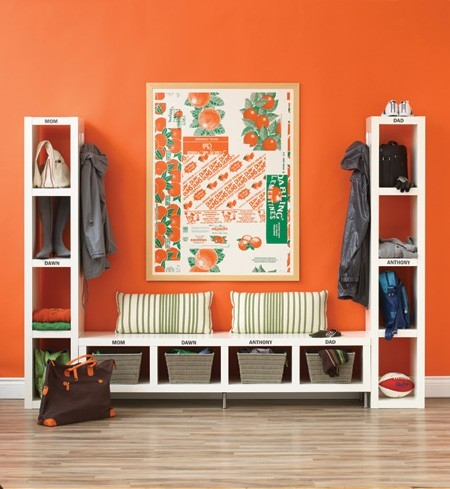 Colourful entryway. Bright orange paint and white Ikea shelves keep this mudroom area chic and organised. Photographed by Mark Burstyn for House & Home March 2008. http://moorbay.tumblr.com