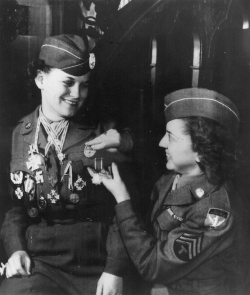 demons:  WACs posing with captured German medals they'd accumulated throughout their tour, 1945