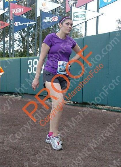 """Beginning of my mental breakdown, right before mile 19.5  I was so excited that the photographers captured that moment.  Really wanted to kick that gravel at them."" - Stephanie, Walt Disney World Marathon - part of the Goofy Challenge, January 13, 2013 Twitter: GooberMonkey78 Blog: www.goobermonkey.com (The Adventures of Goober Grape and Monkey Man)"