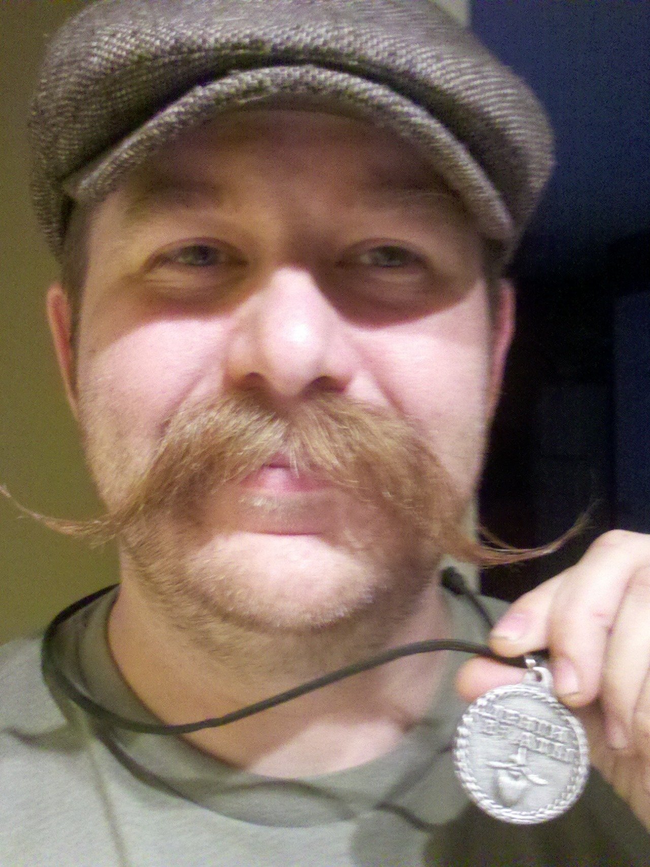 Dave Freeland with his kickass moustache and Beard Token necklace. Get your own Beard Token at http://beardtoken.com