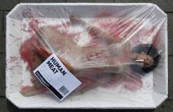 "fotojournalismus:  An animal rights activist protests against meat consumption through a performance to promote vegetarianism during ""Day Without Meat"" in central Barcelona on March 20, 2013. [Credit : Albert Gea/Reuters] (via lefigaro-photos)"