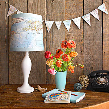 Map Lamp | Better Homes & Gardens DIY projects just don't get any easier than this. If you have a plain lamp that needs a little TLC, locate a map, some spray adhesive, and some ribbon. Your map can come from anywhere, pull it out of a magazine or an atlas. Cut one to fit your measurements. You can antique your map as well if you want a more vintage look. Try tea-staining, burning the edges, crumpling, etc. to get the look you're going for. Use a map of a place special to you, such as your hometown, your college city, the town where you met your significant other, or a place you've always wanted to go. Then use spray adhesive to attach your map to your plain old lampshade, press it down, and add some grosgrain ribbon to the tops and bottoms if you want. Adds a great vintage touch to any desk, and takes less than 20 minutes!