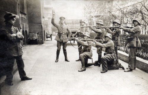 "collectivehistory:  Execution of a German Communist in Munich, 1919  On 3 May 1919, loyal elements of the German army (called the ""White Guards of Capitalism"" by the communists), with a force of 9,000, and Freikorps (such as the Freikorps Epp and the Marinebrigade Ehrhardt) with a force of about 30,000 men, entered Munich and defeated the communists after bitter street fighting in which over 1,000 supporters of the government were killed. About 700 men and women were arrested and summarily executed by the victorious Freikorps troops.  Flickr"