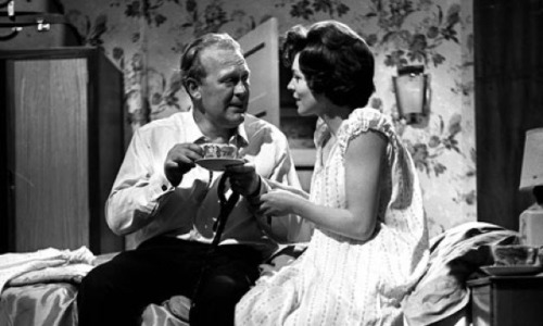 """Armchair Theatre"" was a drama anthology series that ran on British television from 1956 to 1974. Early episodes were broadcast live, and it was during a November 1958 episode that some of the types of problems inherent to live broadcasts became apparent. Actor Gareth Jones, who was only 33 years old at the time, was in makeup in between scenes when he suffered a massive heart attack. As the show continued on the stage, Jones collapsed and died—the only actor at the time to have expired during a live television transmission. The director and producer scrambled to improvise around his absence, and the play actually carried on to its conclusion as the dead actor was whisked off the set. A couple of odd asides: Jones' character was actually supposed to have a heart attack at a later point in the play; and the director, Ted Kotcheff, would go on to direct Hollywood films, including First Blood and… Weekend At Bernie's, which is about a couple of dudes trying to cover up around their boss' absence after he inconveniently dies. We doubt the irony was lost on Kotcheff."