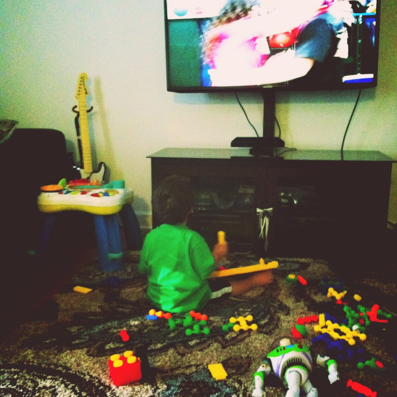 Playing with blocks and watching his Fav Disney channel. – View on Path.