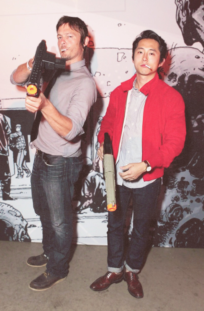 blame-it-on-my-a-d-d-baby:  Norman Reedus and Steven Yeun (aka BAMFs) at San Diego ComicCon 2011 [X]