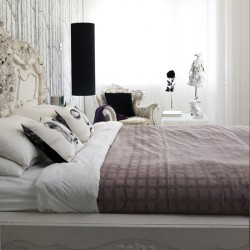 designed-for-life:  Light, bright bedroom This room balances the appeal of simple, neutral colours with classic glamour. An ornate armchair upholstered in cream fabric and painted white offers comfort and style, while flashes of black in the form of patterned cushions, a lamp and ornament create dramatic contrast. A modern wallpaper works well here as it is a subtle design in the same colours used in the rest of the room.