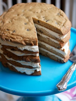 Giant Layered Cookie Cake Ingredients:  4 cups flour 1 1/2 teaspoons baking soda 1 1/2 teaspoons salt 8 tablespoons (1 stick) unsalted butter, softened 1 1/2 cups light brown sugar 3/4 cup white sugar 3 teaspoons vanilla extract 2 eggs plus 2 egg yolks 3/4 heavy cream 2 cups chocolate chips 2 pounds (4 8-ounce packages) cream cheese 1/2 cup confectioners' sugar, sifted For full recipe click here.