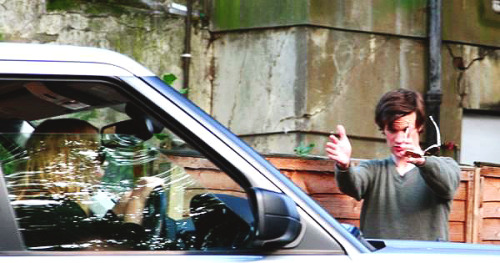 Matt Smith helping Billie Piper park her car.