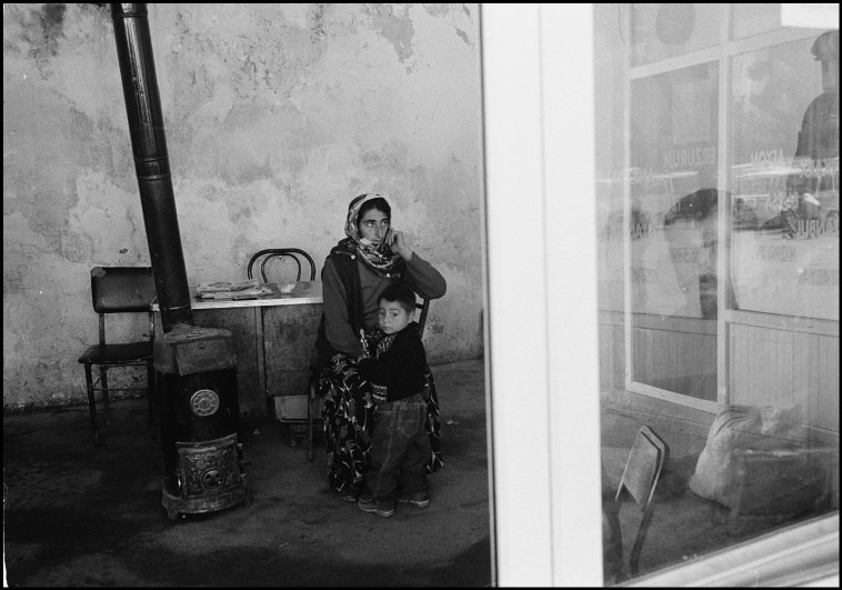 In a local cafe waiting for the bus. Southeast Turkey, 2004. [Credit : Nikos Economopoulos]