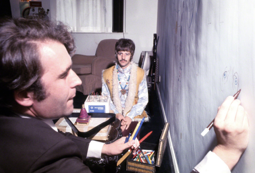 Cartoonist Gerald Scarfe sketches Ringo Starr in 1967, drawing directly onto the wall of Ringo's game room.  Photo taken by Henry Grossman