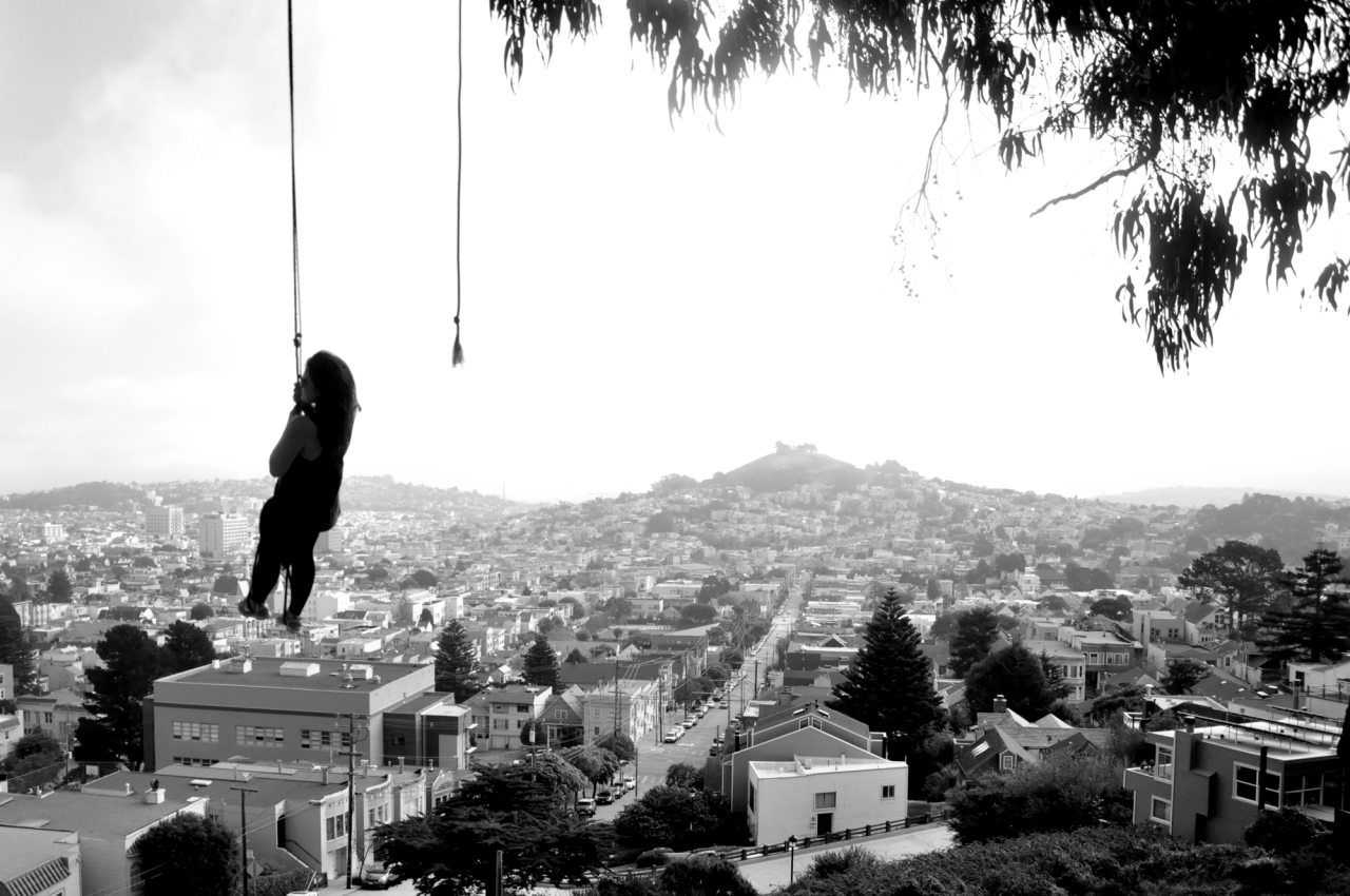 Andi swings high above the city