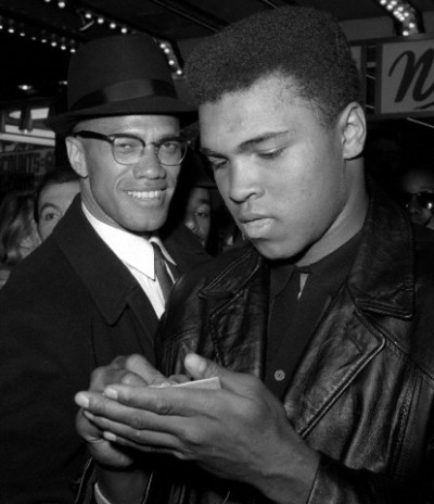vintageblackglamour:  Malcolm X was born Malcolm Little in Omaha, Nebraska 88 years ago today in 1925. He would later change his name to El-Hajj Malik el-Shabazz. In this photo from March 1964, he is shown with Muhammad Ali outside of the Trans-Lux Newsreel Theater in New York City after a screening of a film about Mr. Ali's title fight with Sonny Liston. Photo: AP/Corbis.