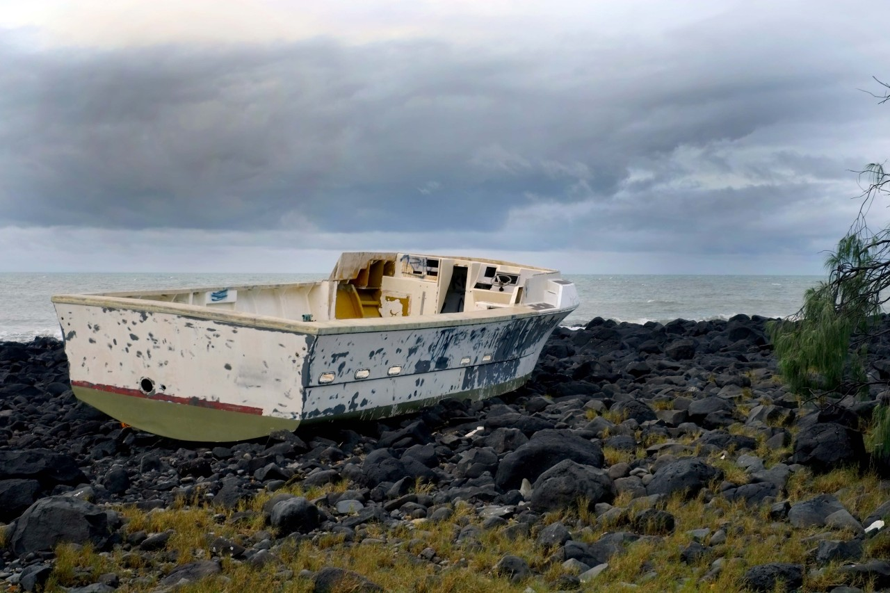 stranded fishing boat. abandoned.