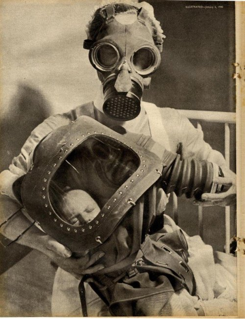 Nurse and baby in gas-masks