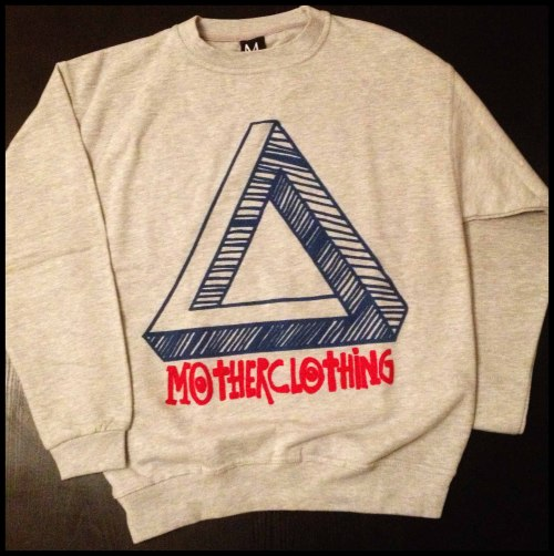 "MOTHER: Impossible Triangle SweatShirt in Retro Grey BUY  MOTHER's original hand-drawn Impossible Triangle design printed on Retro Grey dyed SwearShirt. There are only 3 of these items available in our  exclusive MOTHER oversized, comfort fit.  Made with MOTHER's expertise and care.  AN INDEPENDENT, ONE OFF RUN OF UNDERGROUND FASHION. DESIGNED AND HAND MADE BY MOTHER. ALL ITEMS ARE EXCLUSIVE AND LIMITED EDITION PIECES.  All MOTHER SweatShirts are made with specialist ""Puff"" Vinyl Based Ink for a high quality embossed effect print. Due to limited runs of our pieces we recommend you treat your MOTHER with care. Please wash at 30 degrees centigrade and do not iron on prints.  http://MOTHERclothing.tumblr.com  MotherClothing@Gmail.Com"