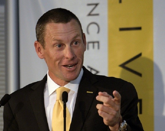 """Charity staff were in tears when disgraced Lance Armstrong turned up at their headquarters to apologise for his drug shame."""