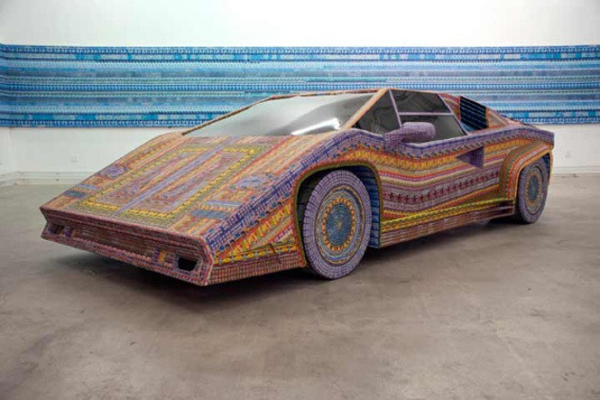 "Art Talk: Turning Dead Lottery Tickets Into Lamborghinis Ghost of a Dream is the collaboration of sculptor Lauren Was and painter Adam Eckstrom, a married couple who first met at Rhode Island School of Design and who now specialize in installation, sculpture, collage, and lottery tickets. To the pair, these colorful slips of paper and cardboard are the most abundant testaments to society's abandoned, failed dreams; they're also fantastically colorful. When they have introduced their ""Dream Car"" and other of their sculptures, mostly made of discarded lotto tickets, they have specifically attempted to match the price to the dollar value of each formerly-unscratched lottery ticket (i.e.$39,000 of lottery tickets for the Hummer ""Dream Car""). Vice's ""Art Talk"" show met them at their studio a few months ago.   CONTINUE - by Alex Pasternack"