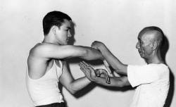 collective-history:  Bruce Lee sparring with Ip Man, ca 1955.