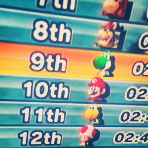 Getting my butt kicked in Mario kart.