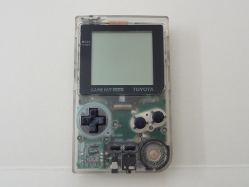 "unscrupul0us:  nintendroid:   Used Japanese Game Boy Pocket - TOYOTA Promo version. This is a Japan exclusive release for a limited number of Toyota clients.  ""Hi there, I drive a 1992 Toyota Nintendo. No gasoline but S.O.B sucks batteries."" Needs a new transmission."" Auction here.  ♡ paler than the cast of twilight ♡"