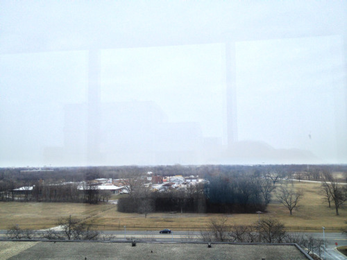 The hallway with windows doesn't have sunshine today. The Chicago skyline is nearly obscured by tiny snow flurries are falling clouds.   January 23, 2013 Loyola hospital near Chicago