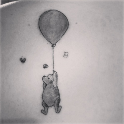 lindsiepaige:  This is my first tattoo. I got a tattoo of Winnie the Pooh because growing up he was my all time favorite Disney character. My nickname was, and to some people still is, Pooh. I believe Pooh is the most uplifting friend anyone could have.