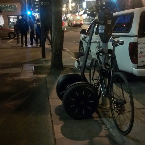 a segway locked to a parking meter. yes, really. 3rd/mission in sf.