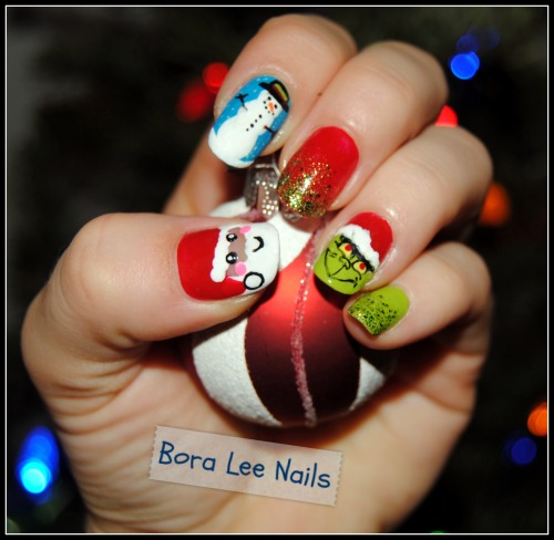 kasnailsandsuch:  boraleenails:  Love how the Grinch came out:) Products used: Confetti: Black Tie, The Red Carpet Wet N' Wild: French White Creme Sally Hansen: Limestone, Sun Kissed, Mellow Yellow Spoiled: Show Me The Money Sinful Colors: Aquamarine, 24/7 Essie: Little Brown Dress  These are so well-done! The Grinch looks especially fantastic/evil.