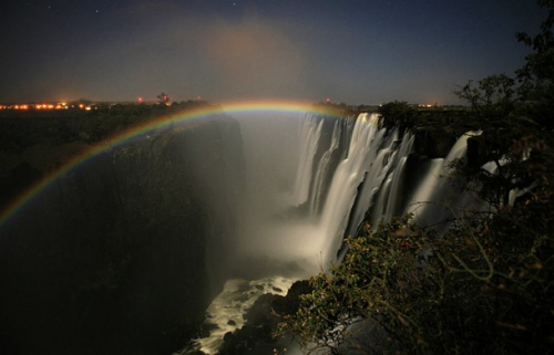 iecoworld:  A moonbow or space rainbow, is a rainbow produced by light reflected off the surface of the moon (rather than from direct sunlight) refracting off of moisture in the air. http://on.fb.me/18MDUp6
