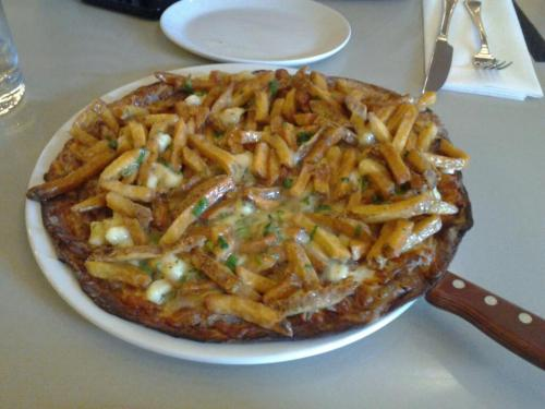 This is Roast Duck Poutine Pizza from Bannock in Toronto.  Needless to say, it was worth every penny in all its deliciousness. Sorry for the terrible photo quality!  Wow, so many amazing foods in one!  Thanks for the delicious submission! Remember, everyone, that you can submit a post or ask a question whenever you'd like. –fyp