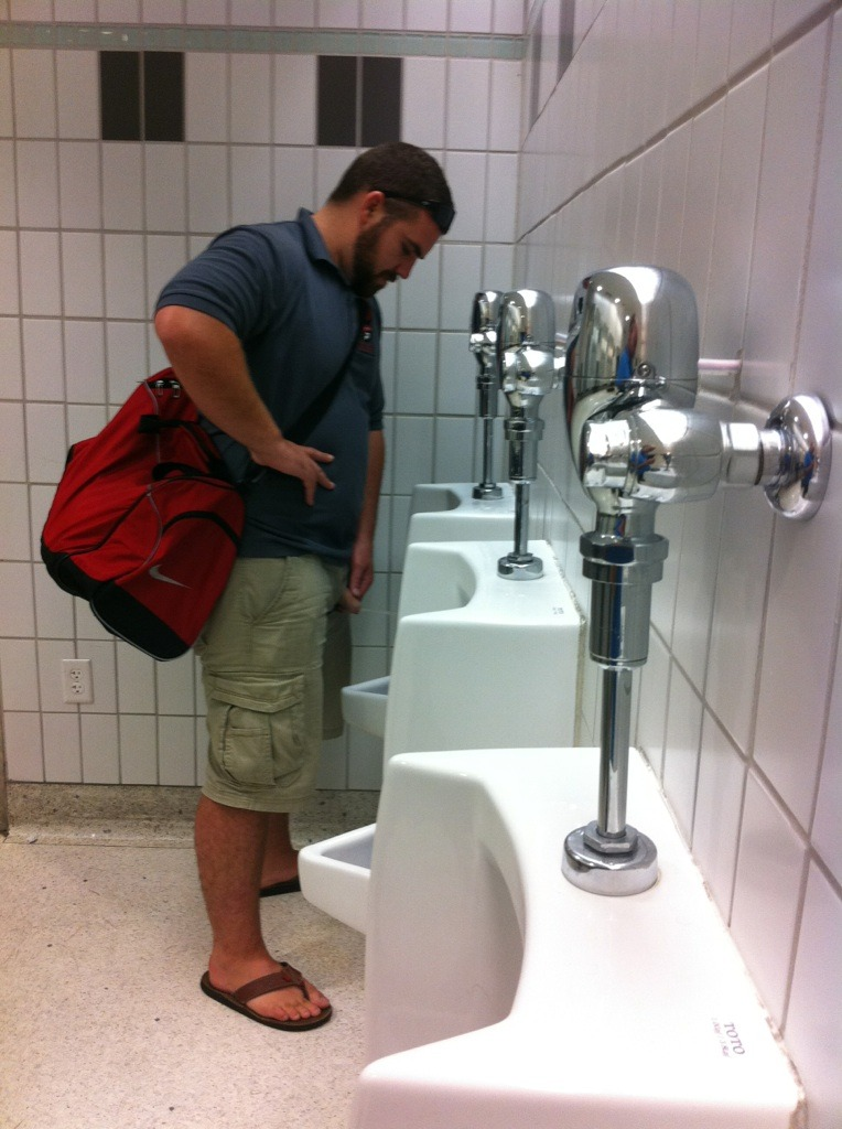Men with erection at urinal