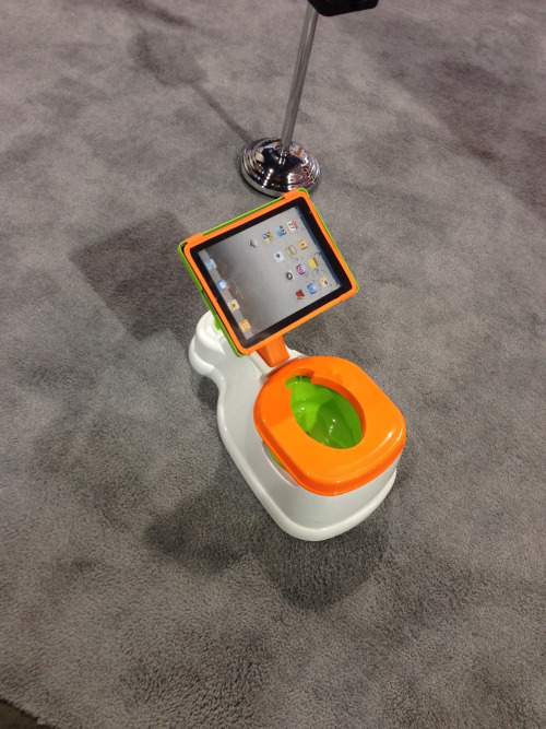 Spotted at CES 2014: iPotty is the training toilet with a holder for an iPad.  Also good for teaching kids how to sit on the toilet backwards. Photo by IHCer DigiDiva.