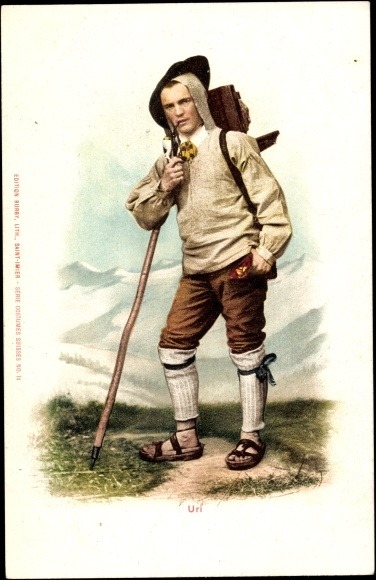 Swiss folk costume from Uri. Mountain man with stick, pipe and rucksack.