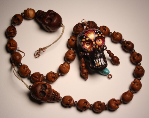Day of the Dead sugar skull necklace from Quiet Mind on Etsy.  https://www.etsy.com/listing/127825164/carved-wood-sugar-skull-necklace-hand