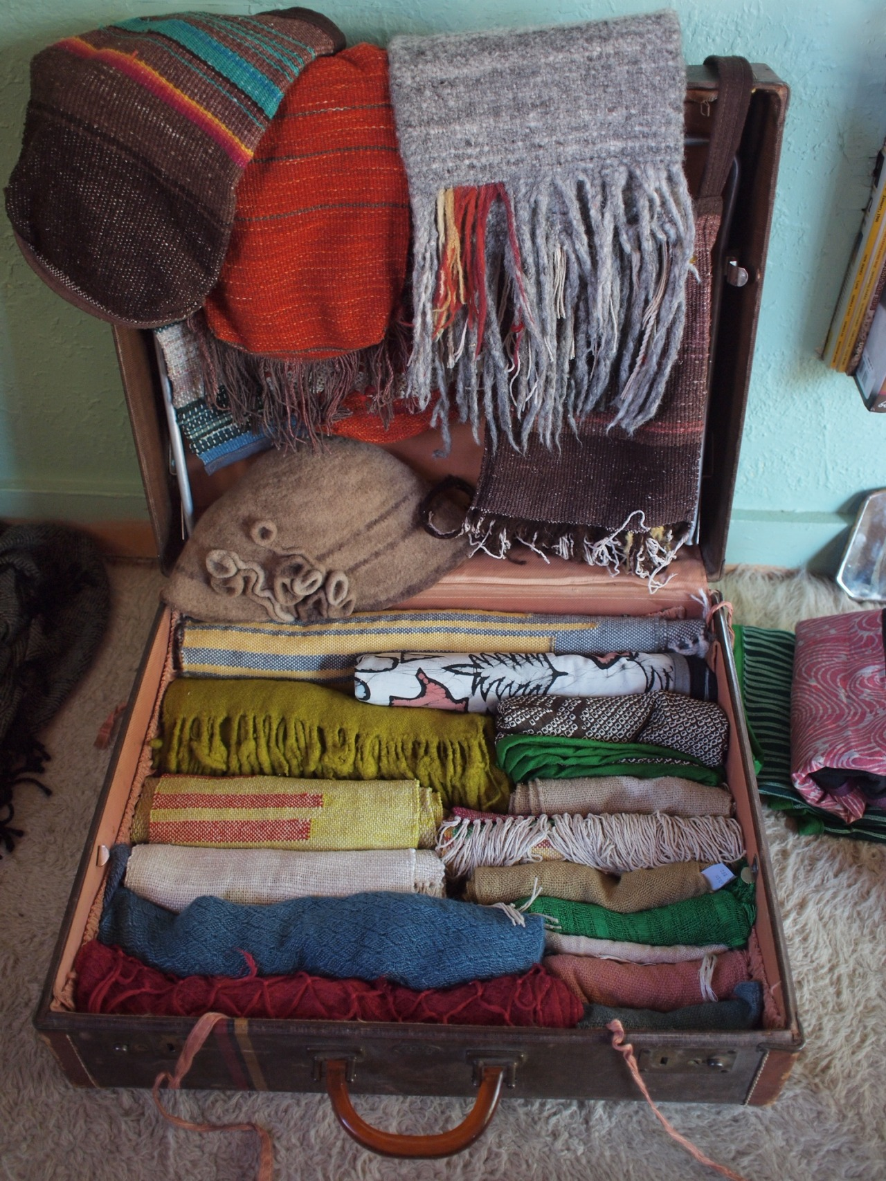 Getting all the scarves, shawls, cowls, bags….packed up for CA