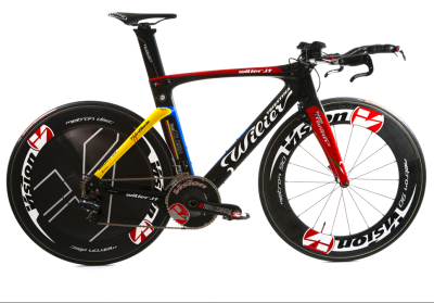 "2013 Team Columbia Edition of the Wilier Triestina Twinblade, due to debut in the Team Time Trial second stage of the Tour of the Mediterranean February 7th. According to their press release, Team Columbia seem to have dubbed themselves the Escarabajos which the dictionary says is either a black beetle - possibly even a dung beetle - or the nickname for a ""thick, short, ill-shaped person."" It's fair to say that second-division Team Columbia is better known for its climbers than its time triallists so this may be the only time you see this colour combo on a Twinblade unless you go and stake out the forthcoming Giro d'Italia yourself - which is not a bad idea. With the horrendous mountain stages coming in both the Giro in May and later Vuelta a España, the lightweight and almost 100% Columbian team riders can afford to have a bit of a laugh at their own small stature as they romp away from the big lads."