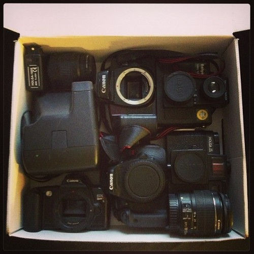 Packing. #Canon #Holga #Polaroid #CameraCollection