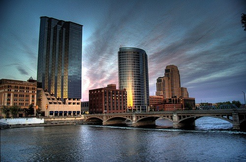 Grand Rapids, MI is my new favorite city. The people of this town have tremendous civic pride, and they show it by electing officials that maintain their standards. In Chicago, right now, multiple public schools are closing. Yet, taxes aren't being cut and they're still charging for Pre-K. The Grand River runs right through downtown Grand Rapids and is clean, scenic and used for recreation. The Chicago river runs right through downtown Chicago and is littered with garbage, tinted with pollution and is not allowed to be used for recreational purposes. The people of Chicago are generally very proud of their city. The people of Chicago and the community within are what make it tolerable to deal with the winters and the government corruption. But when something as simple as public education isn't even free, I can't even deal. I want my son to grow up in a city, one in which he has access to plenty of open spaces, the best education he can get and a myriad of outdoor activities to engage in when he's not in school. The fact that this is available only 3 hours from the city I love so much, and the people that have held my family up for the last 5 years is tremendous, and a huge bonus if you ask me. A thriving punk scene in Grand Rapids? Double bonus. It's just Jimmy that needs convincing.