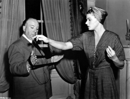 Alfred Hitchcock helps Ingrid Bergman with her knitting on the set of Spellbound.