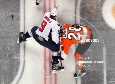 sportbygettyimages:  Washington Capitals v Philadelphia Flyers Claude Giroux of the Philadelphia Flyers faces off with Mike Ribeiro of the Washington Capitals on February 27, 2013 at the Wells Fargo Center in Philadelphia, Pennsylvania. The Flyers went on to defeat the Capitals 4-1. Photo by Len Redkoles/NHLI via Getty Images  Ha lol I think he may be gay