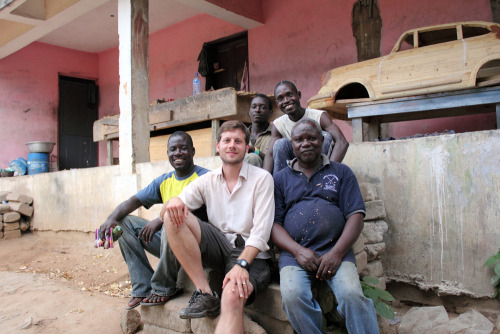 Filmmaker, Ben Wigley, with Paa Joe (front right), his son & business partner, Jacob (back right) and staff.
