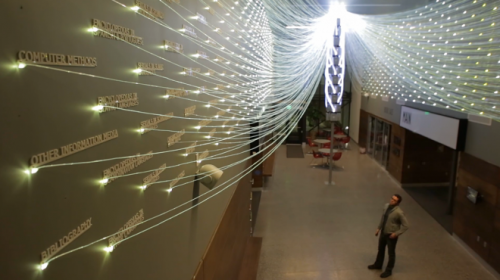 Massive Fiber-Optic Installation Lights Up Library Queries  Getting a glimpse into the curious minds of others has never been so beautiful – or so bright. Designers Brian W. Brush and Yong Ju Lee of E/B Office New York created an extensive fiber-optic installation for the Teton County Library grand opening in Wyoming that visualizes library searches in flashes of colored light. Dubbed Filament Mind, the installation, which opened at the end of January, uses over five miles of fiber-optic cables and 44 LED illuminators to collect, categorize, and render searches from libraries all across the state of Wyoming into glowing bursts of color.  » via Wired