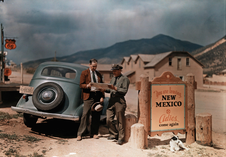 natgeofound:  A tourist stops to get directions from a cop in New Mexico.Photograph by Luis Marden, National Geographic