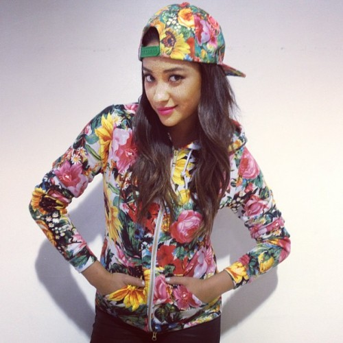 "shaymitchdaily:  Shay Mitchell from ""Pretty Little Liars"" can't get enough of her Joyrich Florals!!! Shay rocks SS13 Joyrich "" Sunrise Blossom Hoodie"" and Hat."