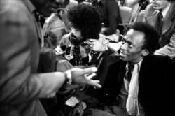 "theyebies:  Miles Davis waiting for the ""Ali vs Frazier"" fight at Madison Square Garden."