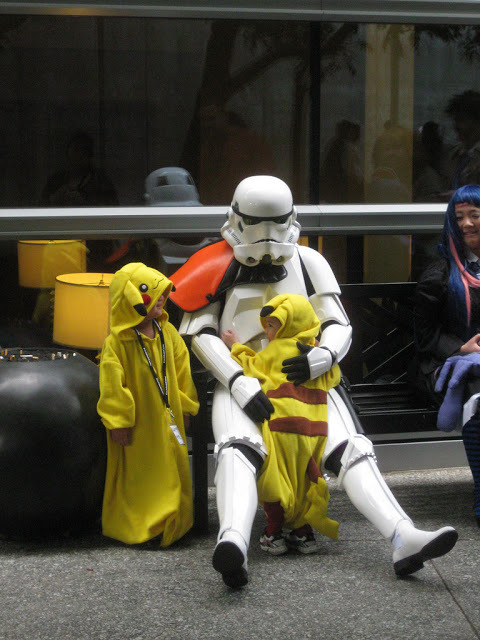 archiemcphee:  We may tend to think of Stormtroopers simply as anonymous henchmen of Galactic Empire, but that's probably because we rarely get to see them with their guard down. Sometimes Stormtroopers grow bone-weary and it's a lucky thing when little Pikachu are there to offer support. This heartwarming and delightfully geeky candid family photo was taken by Coolmikeol during FanimeCon 2011 in San Jose, CA. Fanime is one of North America's largest anime conventions and has been running since 1994. You can revisit this photo any time you like over at the Department of Awesome Parenting. Click here to view more of Coolmikeol's Fanime 2011 photos. [via Figure.FM]